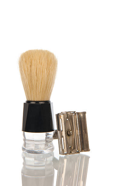 Traditional razor with shaving brush Vintage steel razor with hairy shaving brush isolated in white shaving brush shaving cream razor old fashioned stock pictures, royalty-free photos & images