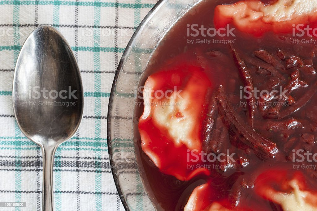 Traditional red borscht with dumplings stock photo