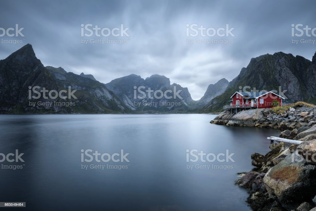Traditional red rorbu cottage in Hamnoy village, Lofoten islands, Norway stock photo