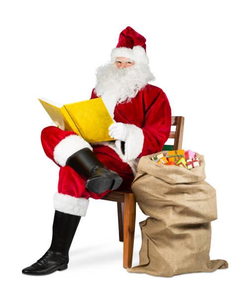 traditionellen roten weißen weihnachtsmann goldene buch - nikolaus geschichte stock-fotos und bilder