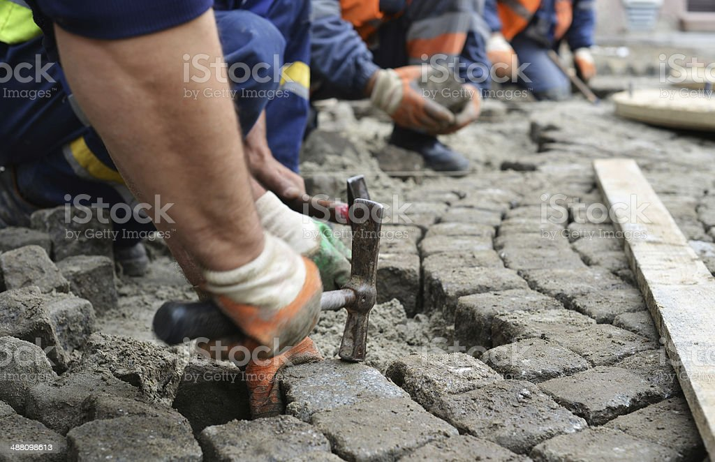 Traditional road paving, restoration stock photo