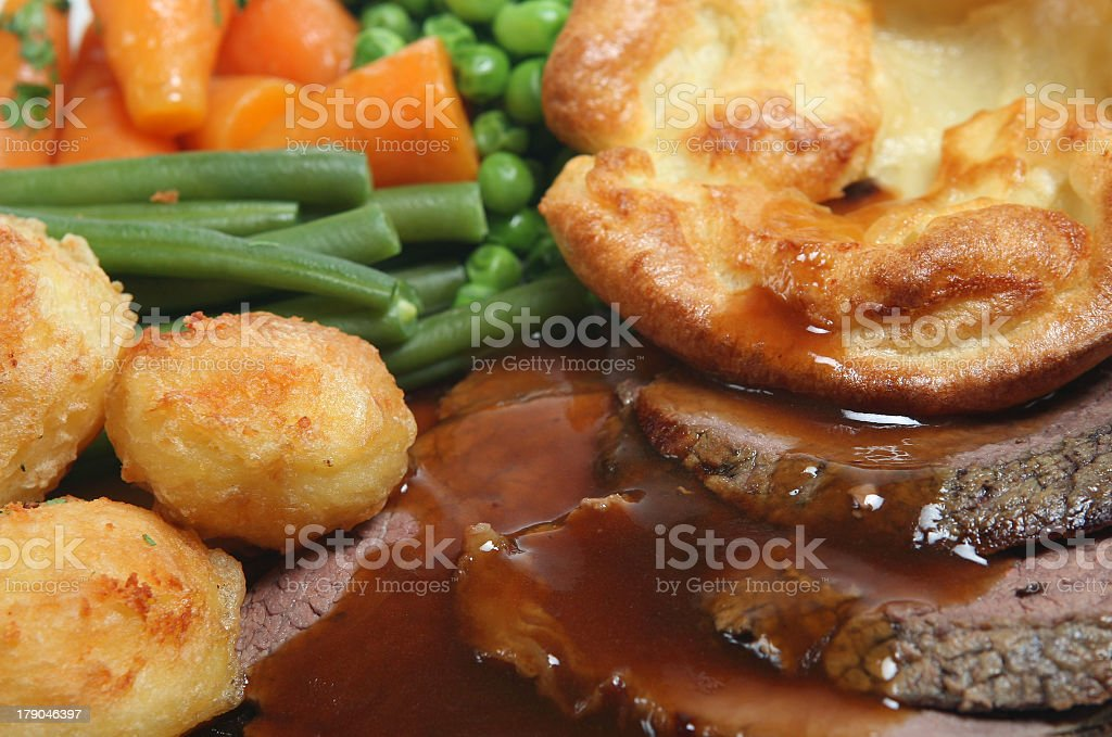 Traditional roast beef dinner with gravy stock photo