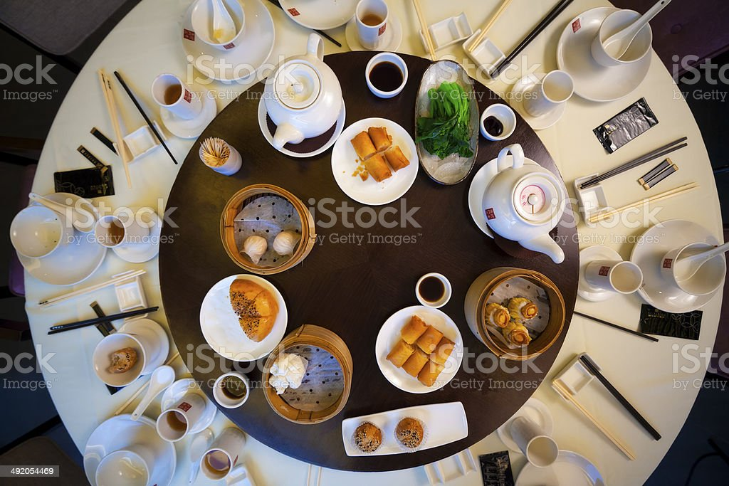 Traditional round table with food stock photo