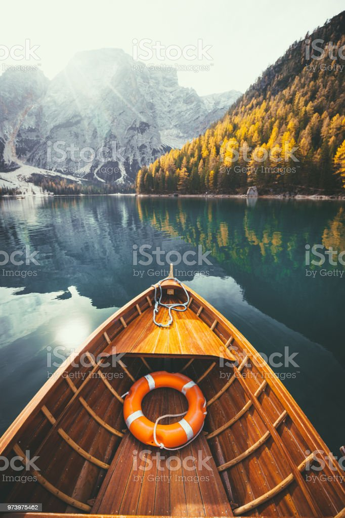 Traditional rowing boat on a lake in the Alps in fall - foto stock