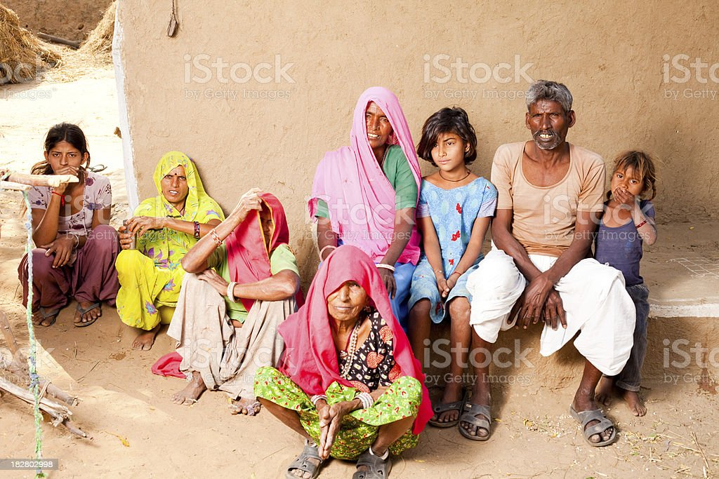 Traditional Rural Indian Family in a village of Rajasthan royalty-free stock photo