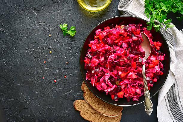 traditional russian beetroot salad vinaigrette on a dark plate . - choucroute photos et images de collection