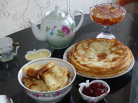 Traditional russian blini. Pancakes. Pancake week. Maslenitsa is an Eastern Slavic traditional holiday, celebrated during the week before the Great Lent. Close-up