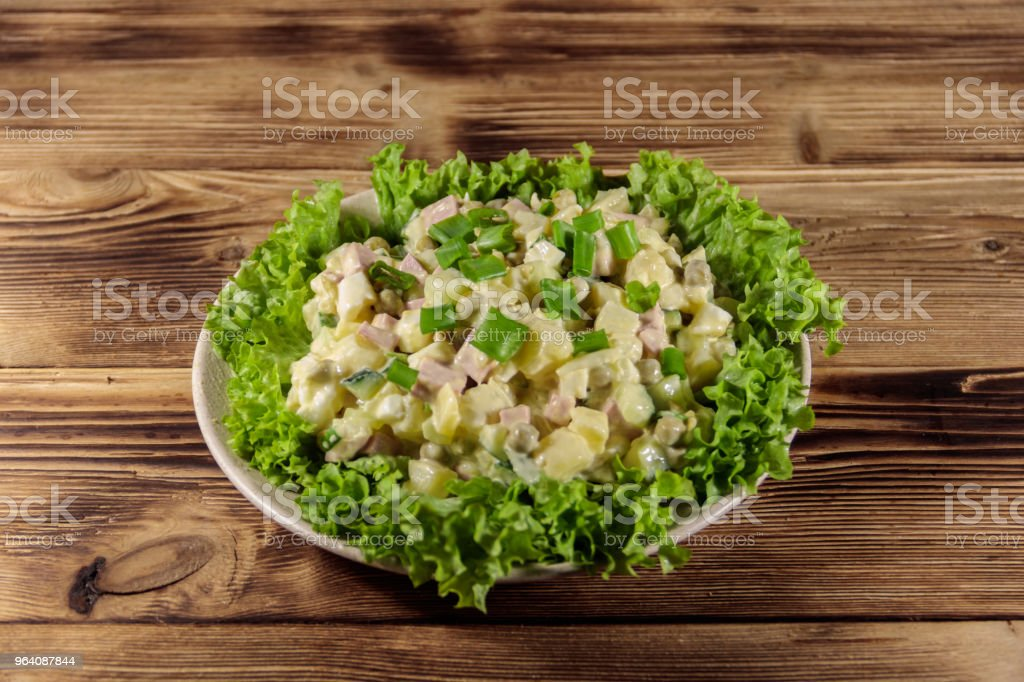 Traditional Russian festive salad Olivier on wooden table - Royalty-free Appetizer Stock Photo
