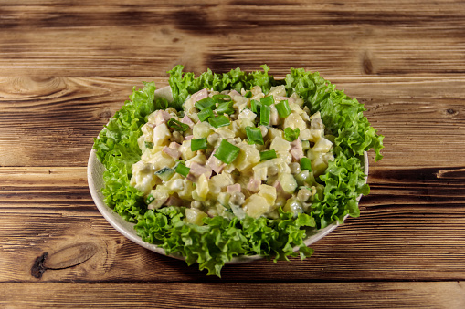 Traditional Russian Festive Salad Olivier On Wooden Table Stock Photo - Download Image Now