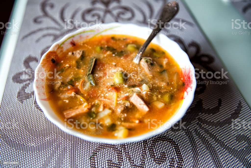 Traditional Russian soup solyanka closeup, view from above stock photo