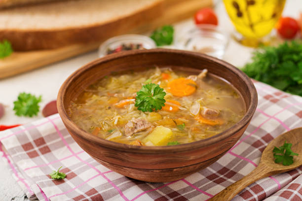 Traditional Russian soup with cabbage - sauerkraut soup. stock photo