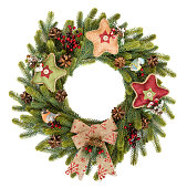 istock Traditional rustic Christmas wreath on white background 1206628670