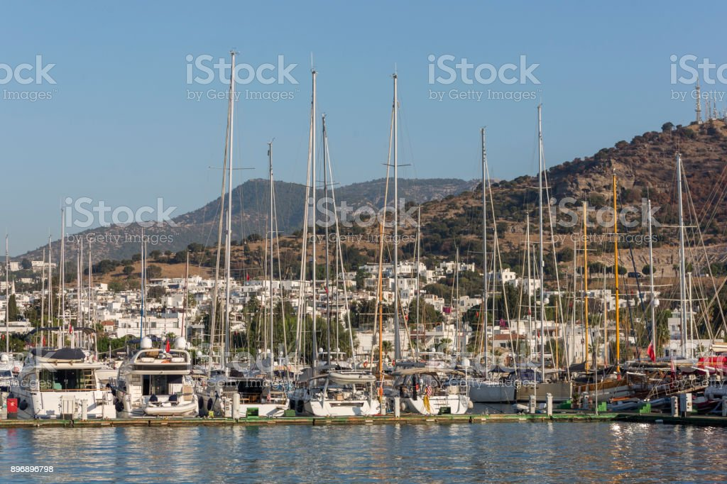 Traditional sailing goulet boats awaiting for blue voyage at bodrum harbour in mugla turkey stock photo