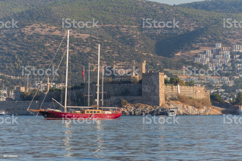 Traditional sailing wooden goulet boat awaiting for blue voyage at bodrum harbour in mugla turkey stock photo