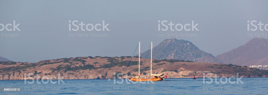 Traditional sailing wooden goulet boat travelling at blue voyage in gokova bay bodrum of mugla turkey stock photo