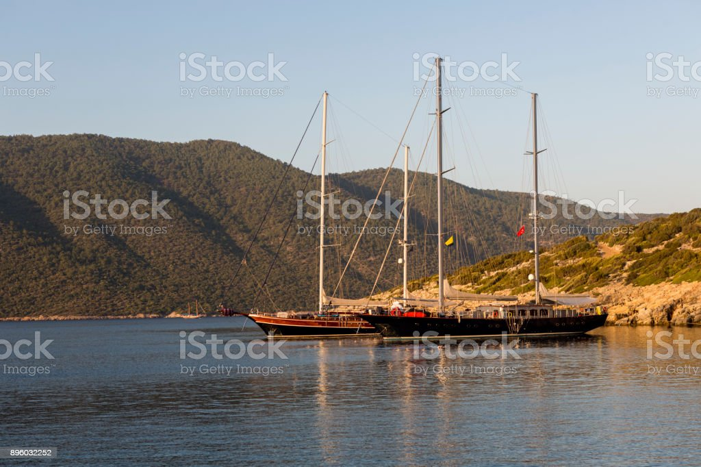 Traditional sailing wooden goulet boats at blue voyage in gokova bay bodrum of mugla turkey stock photo