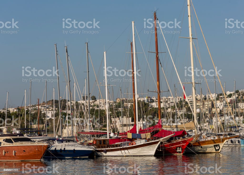 Traditional sailing wooden goulet boats awaiting for blue voyage at bodrum mugla turkey stock photo