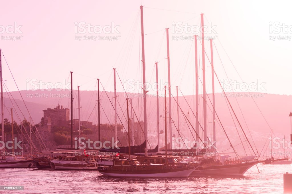 Traditional sailing wooden goulet boats awaiting for blue voyage at bodrum harbour in mugla turkey stock photo