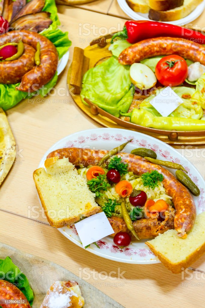 Decorated sausages with fresh vegetables are exposed on traditional...