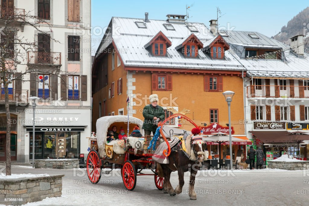 Traditional Savoy horse-drawn vehicle on the central street of mountain city stock photo