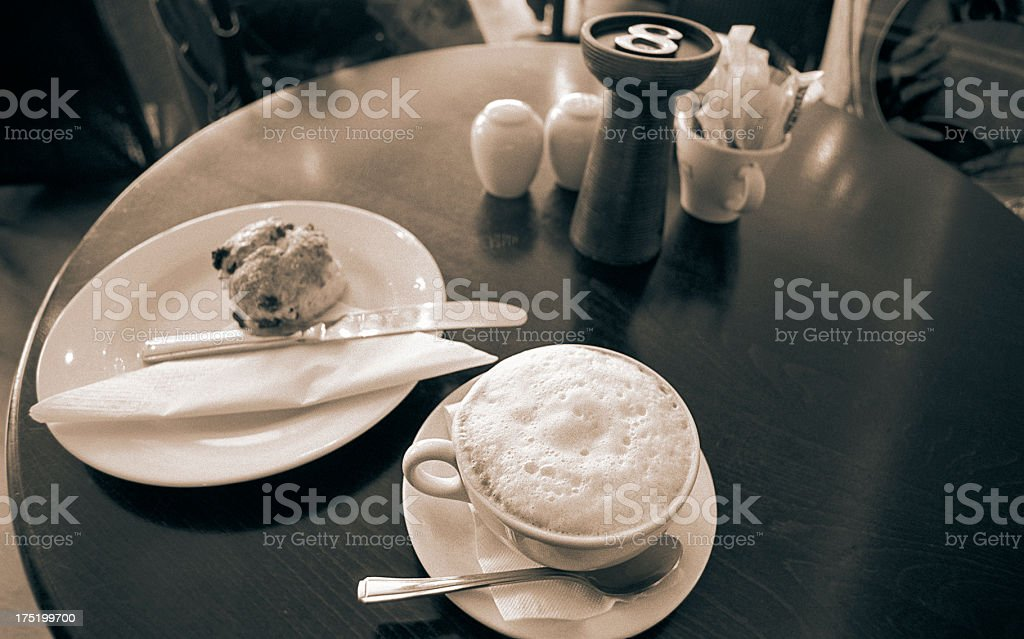 Traditional scone with cappuccino  - British culinary habit royalty-free stock photo