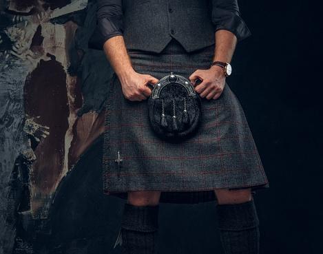 Traditional Scottish costume. Kilt and sporran.