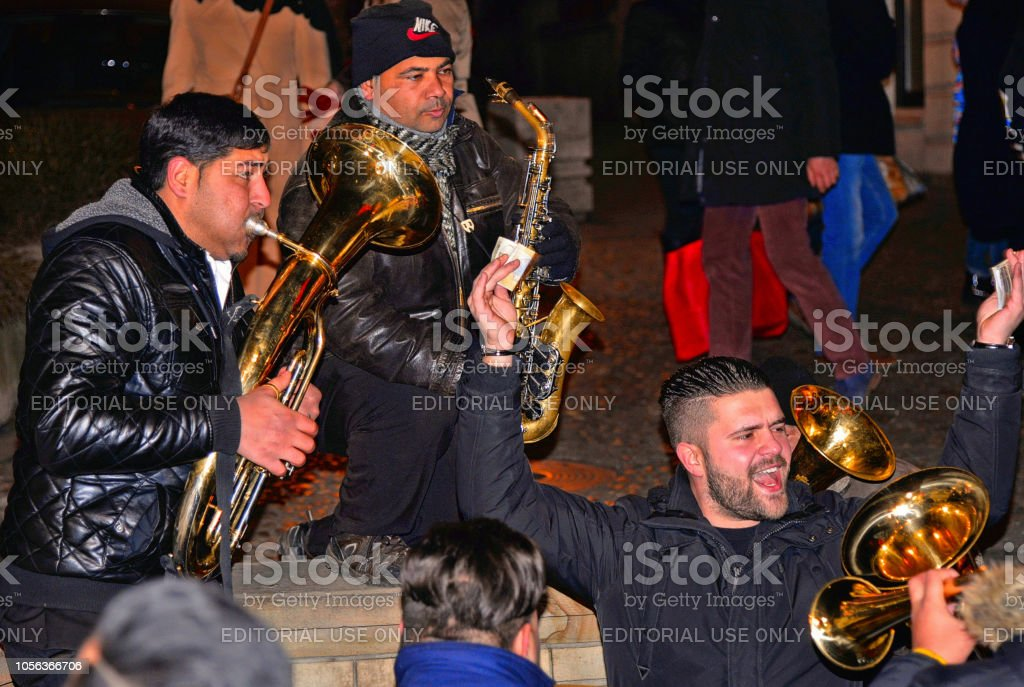 . Traditional Serbian street party with gipsy trumpeters and people...