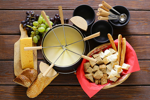 Traditional set of utensils for fondue, with bread, cheese, grapes – Foto