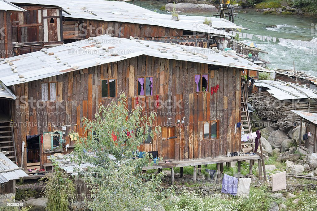 Traditional settlement on the banks of a river near Thimphu foto