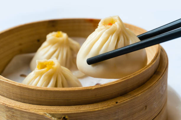 traditional shanghai dumpling, also called xiaolongbao - dumplings stock photos and pictures