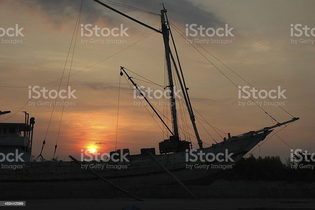 Traditional  ship with Sunset Background royalty-free stock photo