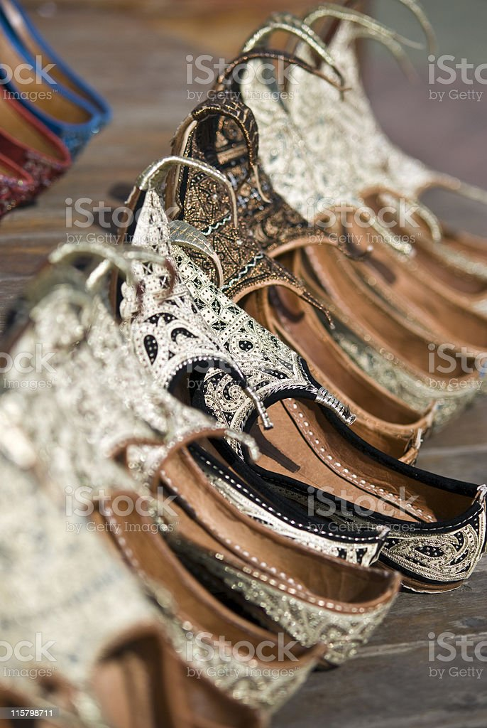 Traditional shoes for sale at the souq or market royalty-free stock photo