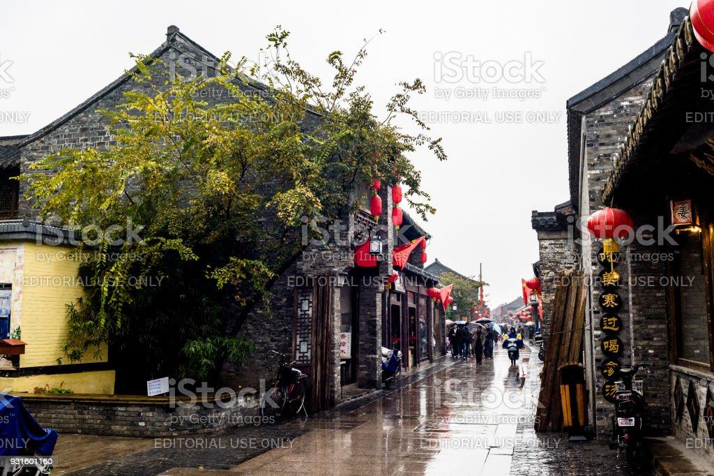 A traditional shopping street in rain in Yangzhou stock photo