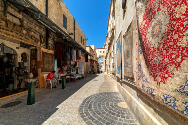 Traditional shops on via Dolorosa street in Jerusalem. stock photo