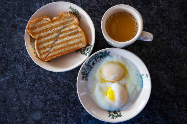Traditional Singapore and Malaysia Breakfast Set of Eggs, Kaya Butter Toast and Coffee stock photo