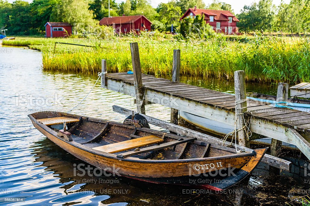 Traditional skiff and homestead - foto de acervo
