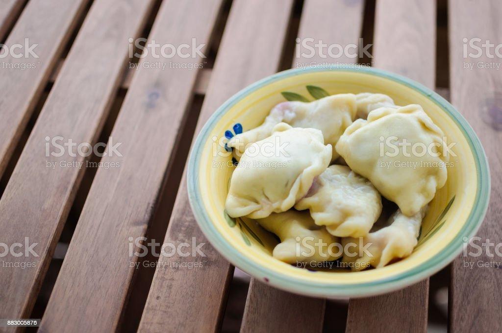 Traditional slavic dumplings or vareniki in plate stock photo
