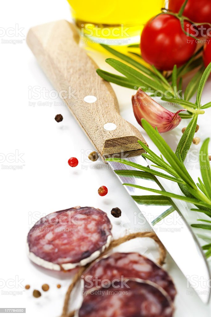 traditional sliced meat sausage salami and vegetables royalty-free stock photo