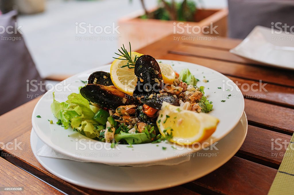traditional slovenial cousine - seafood salad with mussels stock photo