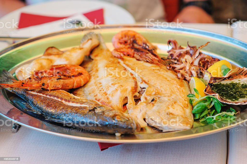 traditional slovenian cousine - mixed grilled fish and seafood stock photo