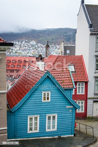 istock Traditional small blue wooden house in Bergen old town 884839296