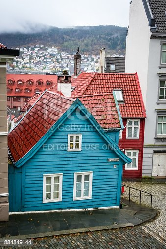 istock Traditional small blue wooden house in Bergen old town 884849144