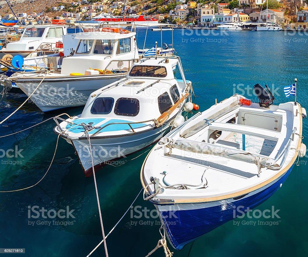traditional small fishing boats docked in port  Symi island stock photo