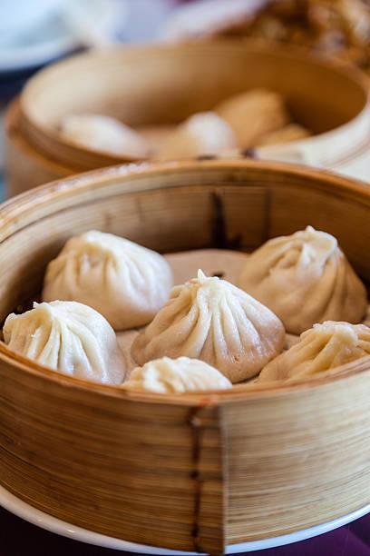 traditional soup-filled pork dumpling - dumplings stock photos and pictures