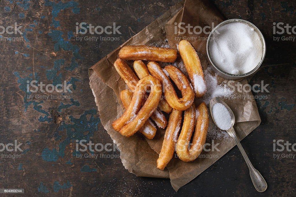 Traditional spanish churros with sugar stock photo