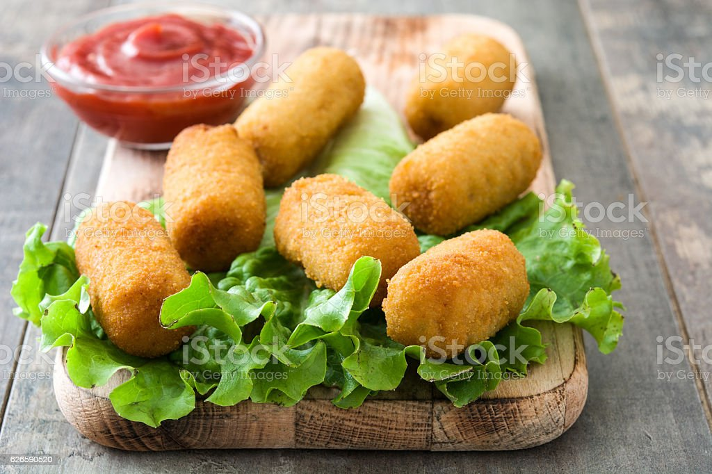 Traditional spanish croquettes with ketchup stock photo