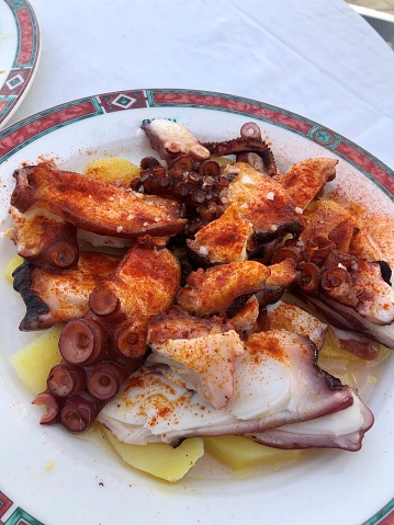 Traditional spanish pulpo a la gallega, octopus with paprika, olive oil and sea salt