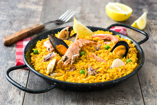traditional spanish seafood paella - paella stock photos and pictures