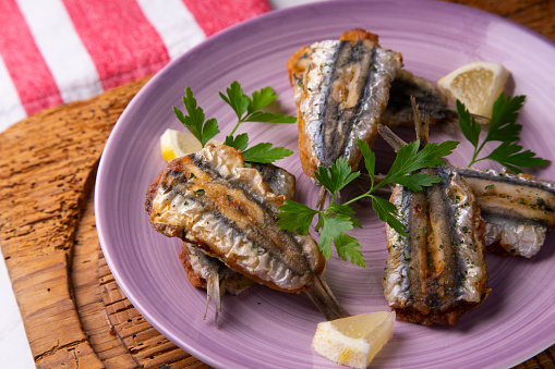 Traditional spanish tapa: Boquerones stuffed with malaga with parsley.