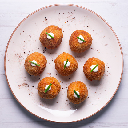 Traditional spanish tapa. Vegan croquettes with avocado from Barcelona